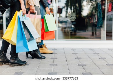Teens with colorful shopping bags