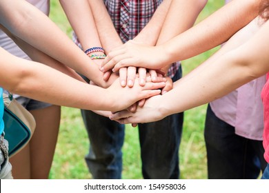 Teens' hands together. Support, teamwork, togetherness concept