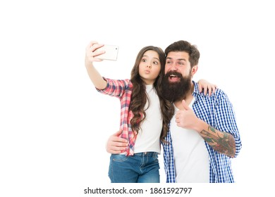 Teens interests. Technology. Happy family. Sharing ideas and having fun. Capture happy moments together. Happy little girl with father. Little child cheerful dad. Father and daughter taking selfie.