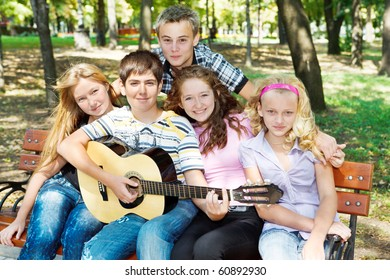 Teens playing guitar and singing