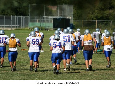Teens playing at a high school football pratice