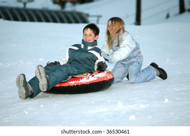 teens playing in the snow, brother and sister