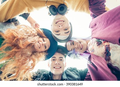 Teens portrait. group of teens hugging together and sharing good mood