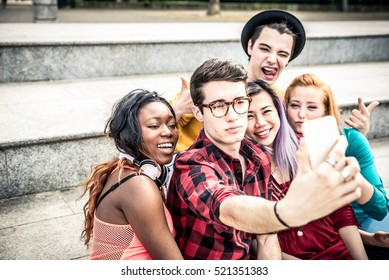 Teens taking selfie with phone