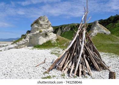 Tee-pee from driftwood and rock formation in Kaikoura, New Zealand