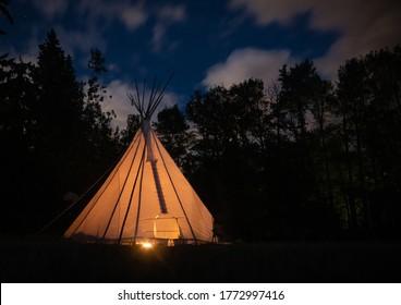 Teepee illuminated at night in Alberta