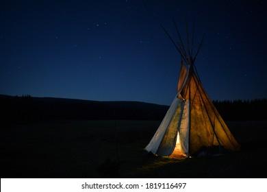 Teepee under the blue night sky