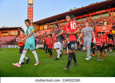 Teerasil Dangda no.10(red)of SCG Muangthong United in action during The Football Thai League between SCG Muangthong United and PT Prachuap F.C.at SCG Stadium on February24,2019 in Nonthaburi,Thailand