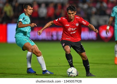 Teerasil Dangda (red) in action during The Football Thai League match between SCG Muangthong United and PT Prachuap F.C.at SCG Stadium on February  24, 2019 in Nonthaburi, Thailand.