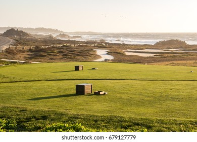 Tees of the Pebble Beach golf club in front of the Pacific Ocean