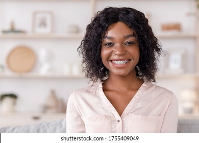 Teeth Alignment Concept. Beauty Portrait Of Black Girl With Dental Brackets Posing At Home, Smiling At Camera, Free Space
