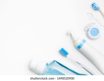 Teeth Brushing Concept with toothbrush, toothpaste, mouthwash and dental floss