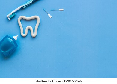Teeth care and dental hygiene. Toothbrush with tube of toothpaste, flat lay