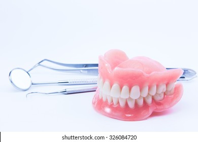 teeth and dental mirror, symbol photo of dentures, diagnosis and copayment