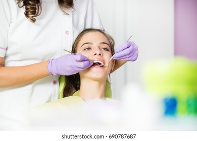 Teeth dentist exam of young girl.Shallow doff