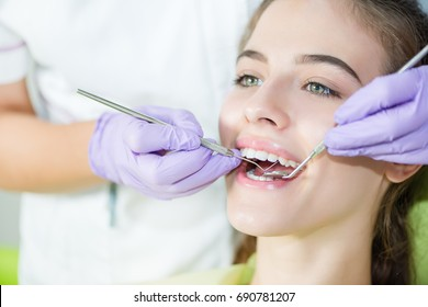 Teeth exam of young girl.Dental exam.Shallow doff