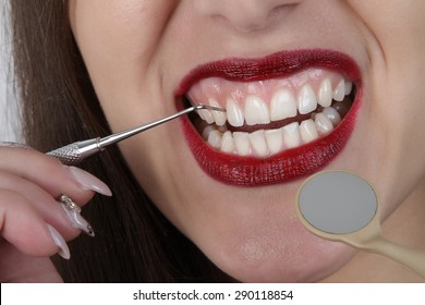 teeth and lips - dental tools - bright red lips with very white teeth beautiful young girl