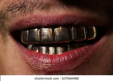 Teeth. Mans gold smile. Perfect gold teeth. Golden teeth grillz