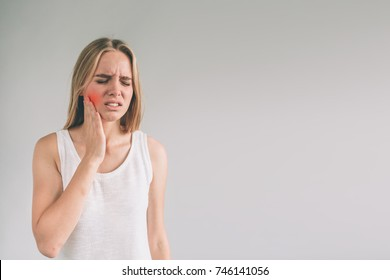Teeth Problem. Woman Feeling Tooth Pain. Closeup Of Beautiful Sad Girl Suffering From Strong Tooth Pain. Attractive Female Feeling Painful Toothache. Dental Health And Care Concept.