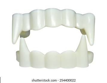 Teeth with sharp fangs against white background.