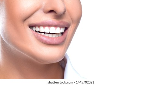 Teeth whitening concept - close up photo of a smiling woman