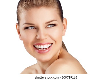 Teeth whitening and cure. Close-up of happy woman with healthy smile isolated over white background.