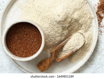 Teff flour on a plate and teff grain with a spoon top view