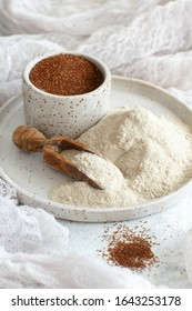 Teff flour in a plate with a spoon top view