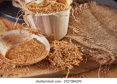 Teff, gluten-free alternative to ancient grains, is popular choice for healthy diet. Burlap and wooden dishes, from natural product Eco friendly and sustainable concept.