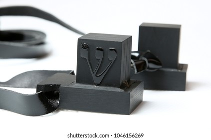 Tefillin -[Jewish phylactery] with black straps on a with blackground