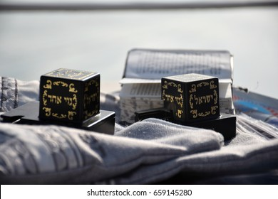 """Tefillin (Judaica item using for the famous jewish prayer """"Shema Israel"""" - hear us our lord) and the Jewish bible on a Shawl bag."""