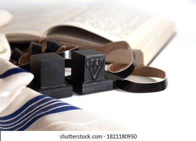 Еallith and tefillin on white background