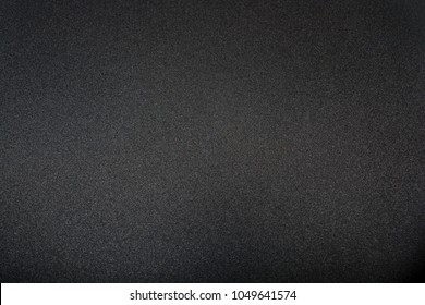 Teflon non-stick frying pan close-up. Kitchen. Black abstract background. Cooking food concept.