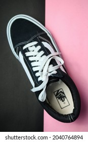 Tegal, Indonesia 09 13 2021:Vans Old Skool black and white sneakers on pink and black background