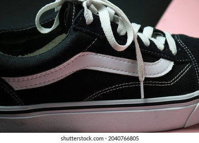 Tegal, Indonesia-September 13 2021:Details of Vans Old Skool black and white sneakers on pink and black background
