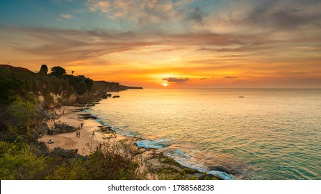 Tegal Wangi Beach with rocky mountains and clear water of Indian ocean at sunset / A view of a cliff in Bali Indonesia / Bali, Indonesia