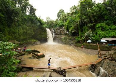 Tegenungan Kemenuh, Bali / Indonesia - December 26 2017: Muddy waters a the Tegenungan waterfall