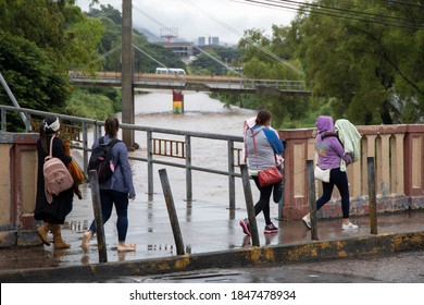 Tegucigalpa, Francisco Morazán/Honduras. November 4 2020. Four women walking in Tegucigalpa, with Eta storm approaching
