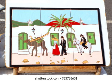 TEGUISE, LANZAROTE, SPAIN - November 11. Market vendor sells ceramic tiles with images of nostalgic traditional life of the Canarian Island at arts and crafts market on November 11, 2017 in Teguise.