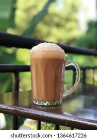 Teh Tarik, a Malaysian delicacy is a mixture of tea and condensed milk, a favourite pass time drink in Malaysia. Focus separation to emphasise the mug.