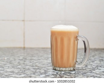 Teh tarik or pulled tea is a famous sweet milk tea in Malaysia. Bubble is floating on the surface of teh tarik.