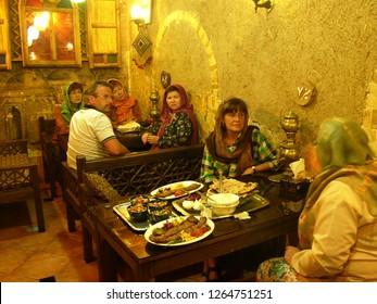 Teheran, Iran / Iran - April 2016: Tourists in a restaurant in Teheran