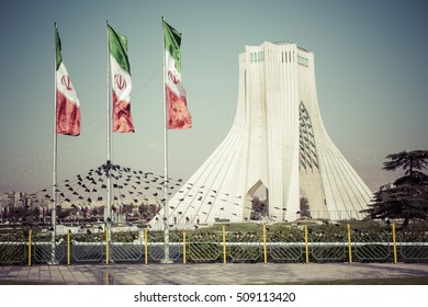 TEHERAN, IRAN - OCTOBER 03, 2016: Azadi Tower with flasgs of Iran, Tehran, Iran