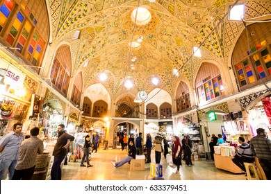 TEHERAN, IRAN - OCTOBER 31:Iranian people shopping  in Tehran Grand Bazaar,  under the beautiful ceiling lets beautiful rays of sun shine from the ceiling downward.  on October 31,2016 in Tehran Iran.