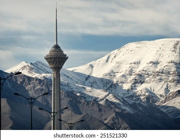 TEHRAN - APRIL 1: Milad Tower of Tehran in front of snow covered Alborz mountains on April 1, 2014 in Tehran, Iran. Milad Tower is the second most famous landmark of Tehran after Azadi Monument.