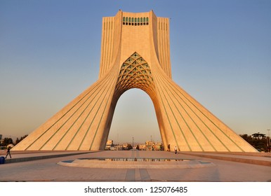 TEHRAN - CIRCA AUGUST 2012: Azadi Tower in the light of the setting sun circa August 2012 in Tehran. Azadi Tower and Azadi Squere are some of the most famous places in Tehran visited by tourists.
