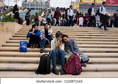 Tehran, Iran – 05 10 2018: Tehran international book fair. The girls take rest in the yard. The Tehran book fair was held in a large space which was made recently.