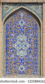 Tehran, Iran, 17 August 2015: Mosaic tile mural at the Shah mosque (Royal Mosque) in central Tehran, built in the early 19th century during the time of the Qajar dynasty.