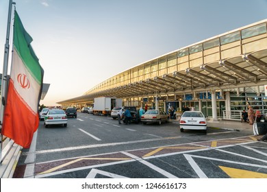 Tehran, Iran - 17 October, 2018: Evening view of Tehran Imam Khomeini International Airport. Entrance to departure hall. The second level of passenger terminal. The flag of Iran is visible at left.