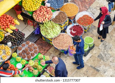 Tehran, Iran - 18 October, 2018: Unusual top view of fruit stall at Tajrish Bazaar. Colorful ripe freshly harvested fruits. The historical market is a popular tourist destination of the Middle East.